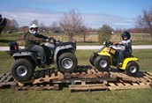 justin and kyle on atv's
