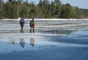 Early Thaw on Frozen Lake